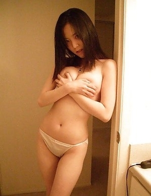 Korean cutie strips naked in the bathroom
