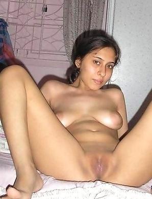 Asian slut posing naked in the house