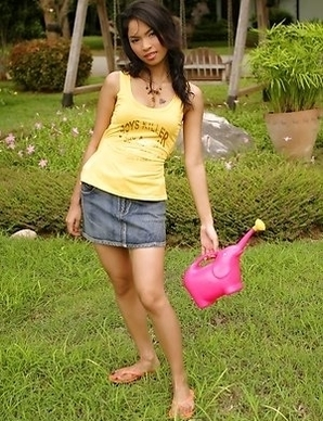 Amara Bhunawat is a sexy gardener that has a knack for making things rise. She gets on a rock and lifts up her yellow top.