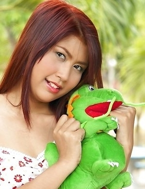 April Lim is definitely one of the sexiest redheads that you have ever seen. She is playing with her stuffed animal and she looks so cute.