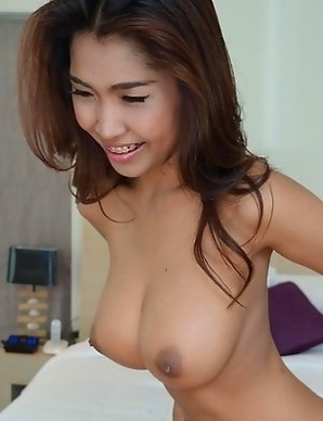 Sexy Thai lovely showing her monster Tits
