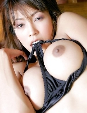 Chan Ching Ming walks around a room and she is wearing sexy black lingerie. Her bra can barely stay over her tits and she is grabbing her panties.