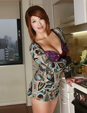 Busty Miwa Nishiki poses in kitchen