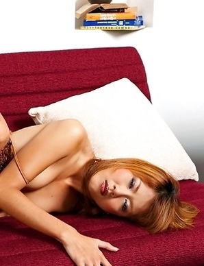 Red-haired girl Jasmine Mookjai pulls her panties off to show her pussy
