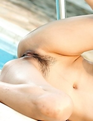 Hot Asian Tina Tao spreads her legs near the pool