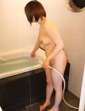 Riko Masaki strips down to pose nude and have her breasts fondled in the shower
