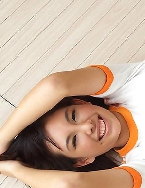 Brunette Ageha Yagyu smiles posing on camera with her pretty body