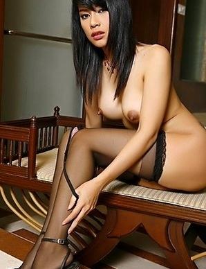 Asian Wanda Tai playing with glass dildo