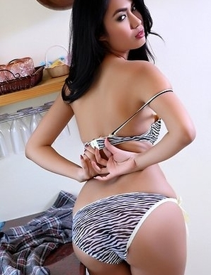 Brunette Asian  Varinda Pan having fun with a pink vibrator on kitchen