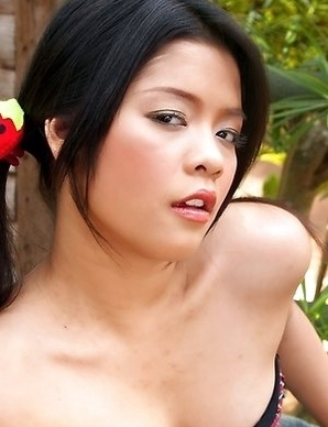Sexy Asian babe Pang Piyatida show her upskirt and playing orange dildo