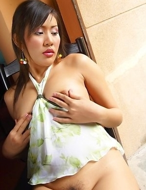 Nutt Kempalee has on a sexy outfit as she has tits that are remarkable. She has her top splitting her tits as her nipples are very hard.