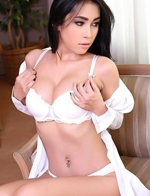 brunette asian girl Melody with big tits takes off her blouse and bra