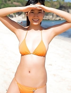 Kaho Takashima in orange swimming suit i playful on beach