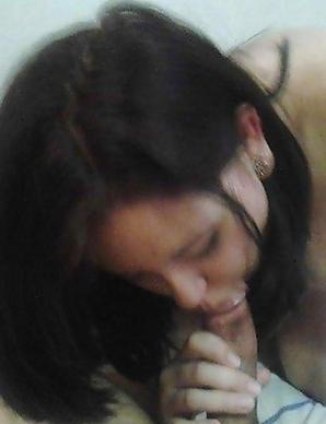 Asian chick sucking on her boyfriend's dick