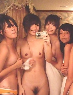 Korean chicks posing naked in a hotel room