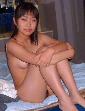 Naughty Asian schoolgirl strips and spreads