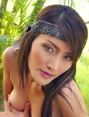Don't miss the sexy Bella Yong as she models in the forest and sports a leopard print headband. She licks her finger and begins taking off her cl