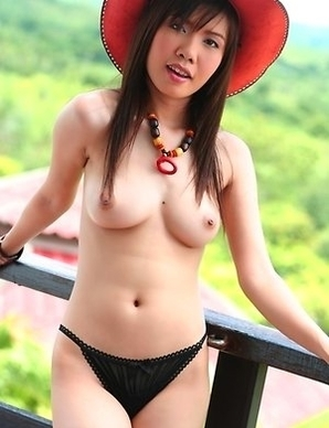 View the sexy Angel Paroon as she pulls down her top and lets her tits out. She has a colourful necklace that accentuates her fantastic nipples.