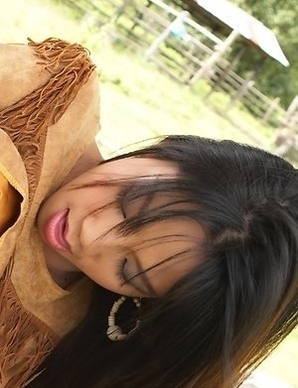 Christina Yho models her best cowgirl outfit as she begins touching herself and rubbing on her pussy.