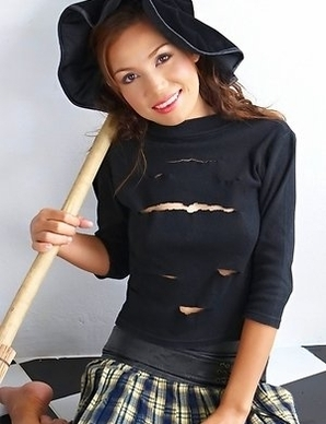 Susan Kim is on her witchy costume with a big, black hat on. Her shirt is torn apart in the right place, meaning on her tits, so you could enjoy watch
